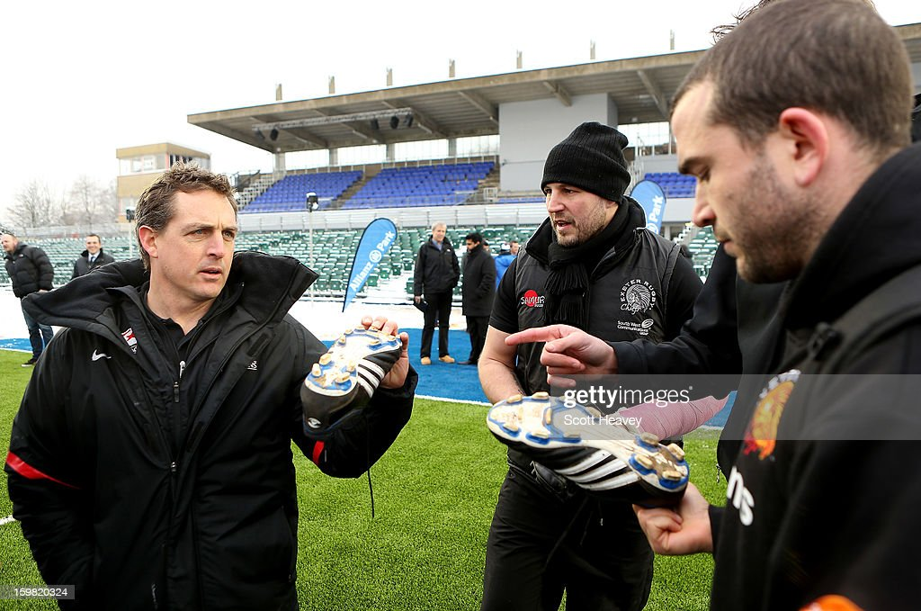 Scott Murphy, High Performance Director of Saracens (L) talks to Brett Sturgess (C) and James Parks of Exeter Chiefs about footwear during a Saracens media day at Allianz Park on January 21, 2013 in Barnet, England.