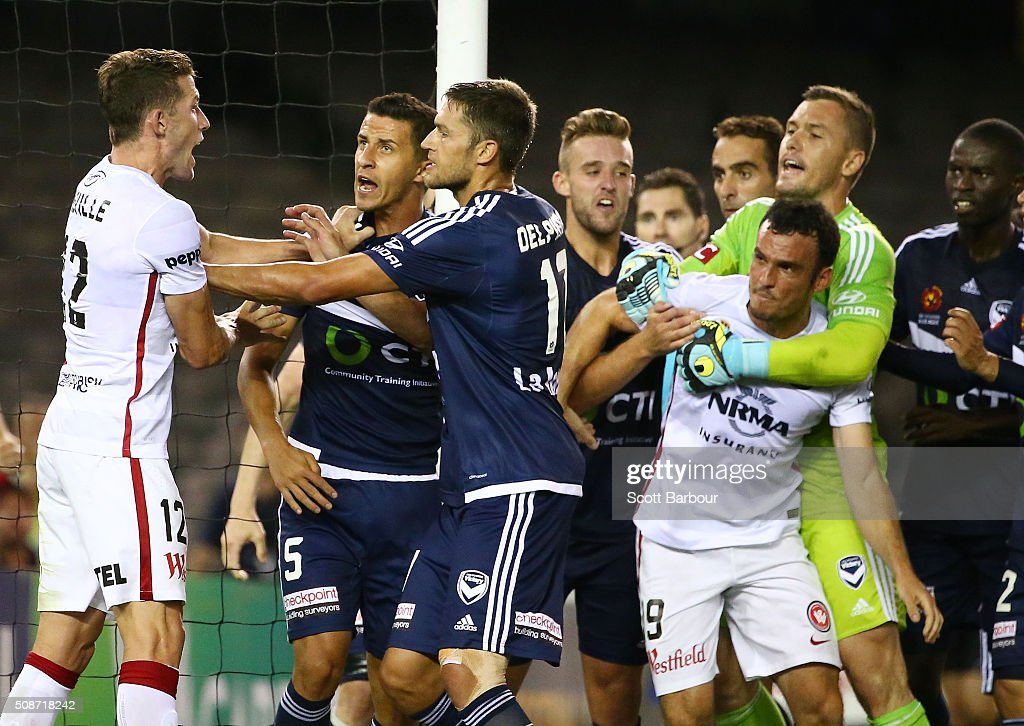 Scott Neville and Mark Bridge of the Wanderers and Matthieu Delpierre and Daniel Georgievski of the Victory wrestle in the 93rd minute during the round 18 A-League match between the Melbourne Victory and Western Sydney Wanderers at Etihad Stadium on February 6, 2016 in Melbourne, Australia.