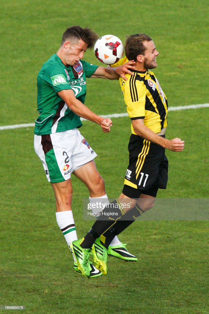 Scott Neville of the Jets and Jeremy Brockie of the Phoenix compete for a header during the round three A-League match between Wellington Phoenix and the Newcastle Jets at McLean Park on October 27, 2013 in Napier, New Zealand.