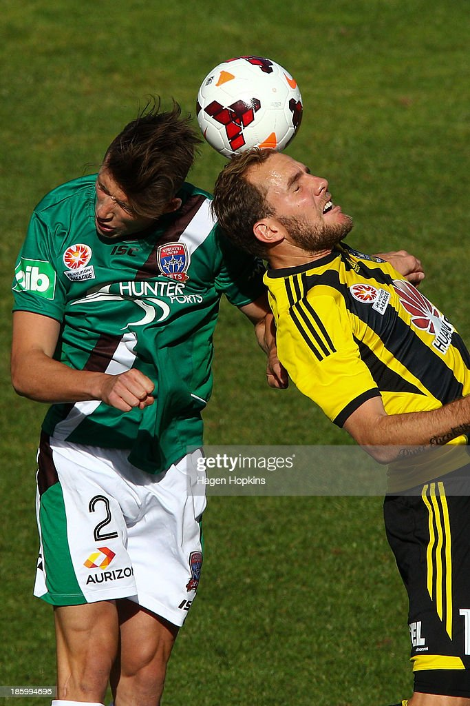 Scott Neville of the Jets and <a gi-track='captionPersonalityLinkClicked' href=/galleries/search?phrase=Jeremy+Brockie&family=editorial&specificpeople=591299 ng-click='$event.stopPropagation()'>Jeremy Brockie</a> of the Phoenix compete for a header during the round three A-League match between Wellington Phoenix and the Newcastle Jets at McLean Park on October 27, 2013 in Napier, New Zealand.
