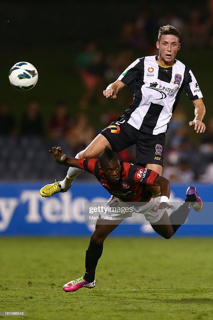Scott Neville of the Jets jumps over the back of Taylor Regan of Wanderers during the round 20 A-League match between the Western Sydney Wanderers and the Newcastle Jets at Campbelltown Sports Stadium on February 9, 2013 in Sydney, Australia.