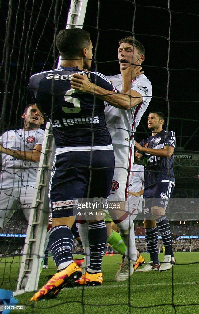 Scott Neville of the Wanderers and Daniel Georgievski of the Victory wrestle in the 93rd minute during the round 18 A-League match between the Melbourne Victory and Western Sydney Wanderers at Etihad Stadium on February 6, 2016 in Melbourne, Australia.