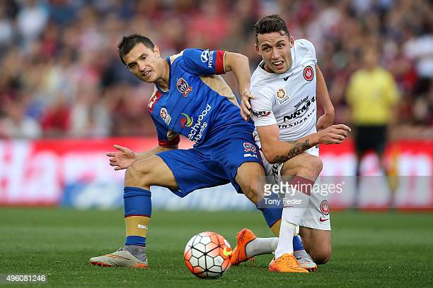 Scott Neville of the Wanderers and Enver Alivodic of the Jets contest the ball during the round five ALeague match between the Newcastle Jets and the...
