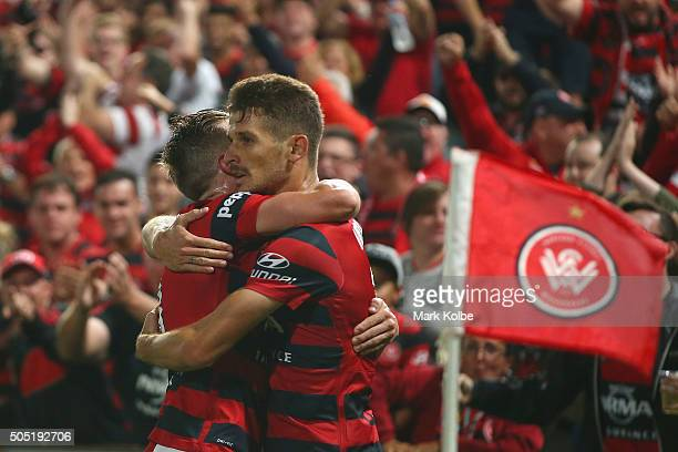 Scott Neville of the Wanderers congratulates Dario Vidosic of the Wanderers as he celebrates scoring a goal during the round 15 ALeague match between...
