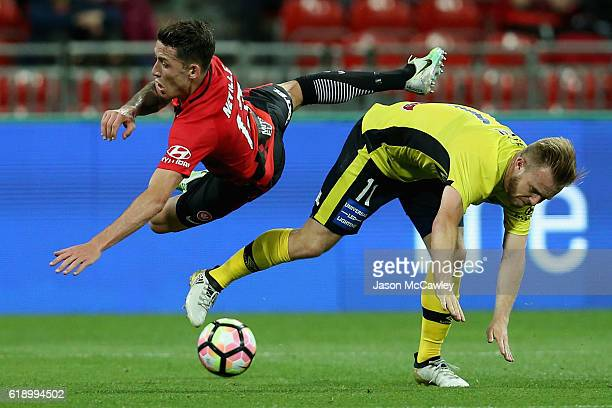 Scott Neville of the Wanderers is challenged by Conor Pain of the Mariners during the round four ALeague match between the Western Sydney Wanderers...