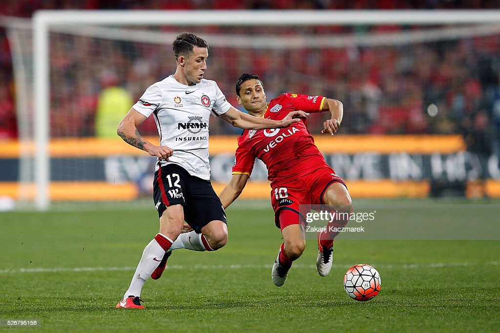 Scott Neville of the Wanderers is challenged by Marcelo Carrusca of United during the 2015/16 A-League Grand Final match between Adelaide United and the Western Sydney Wanderers at Adelaide Oval on May 1, 2016 in Adelaide, Australia.