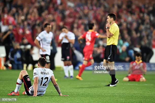 Scott Neville of the Wanderers shows dejection after the 2015/16 ALeague Grand Final match between Adelaide United and the Western Sydney Wanderers...