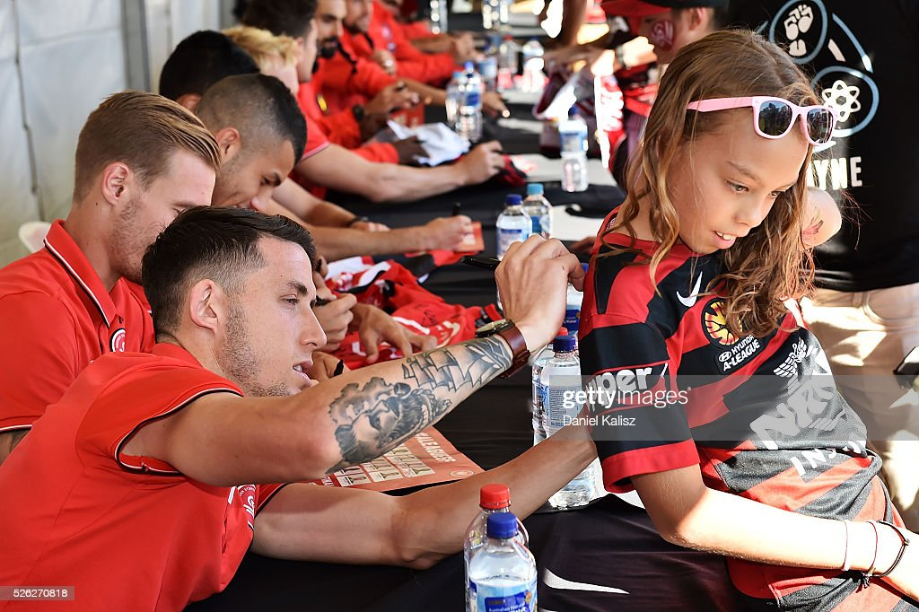 Scott Neville of the Wanderers signs an autograph for a fan during the A-League Grand Final Fan Day at Bonython Park on April 30, 2016 in Adelaide, Australia.