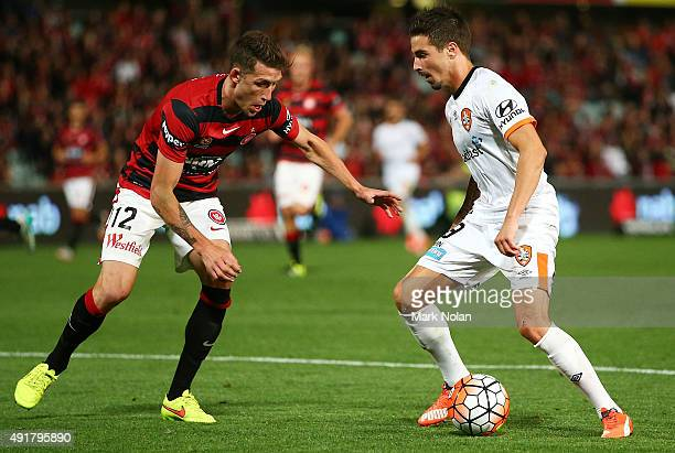 Scott Neville of the Wanderers tackles Jamie Maclaren of the Roar during the round one ALeague match between the Western Sydney Wanderers and the...