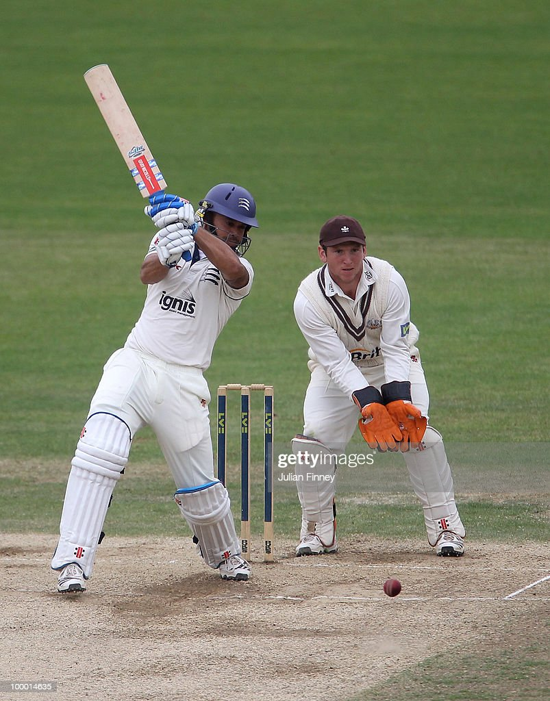 Scott Newman of Middlesex in action as Gary Wilson of Surrey watches on during day four of the LV= County Championship Division Two match between Surrey and Middlesex at The Brit Oval on May 20, 2010 in London, England.