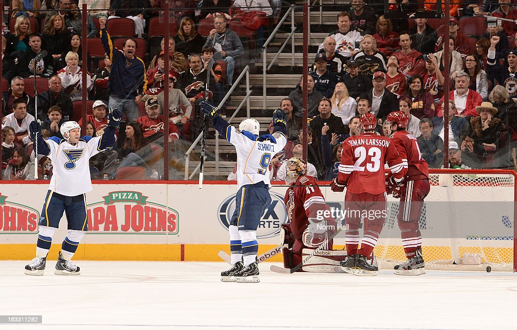 Scott Nichol and Jaden Schwartz of the St Louis Blues celebrate in front of goalie Mike Smith of the Phoenix Coyotes after Nichol's second period...