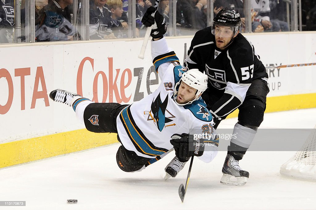 Scott Nichol of the San Jose Sharks is knocked down by Alec Martinez of the Los Angeles Kings in the first period of game six of the Western...