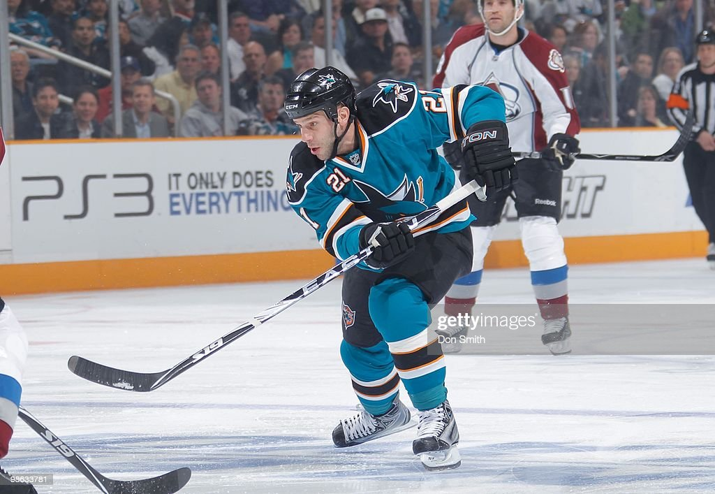 Scott Nichol of the San Jose Sharks skates in front of Stephane Yelle of the Colorado Avalanche in Game Two of the Western Conference Quarterfinals...