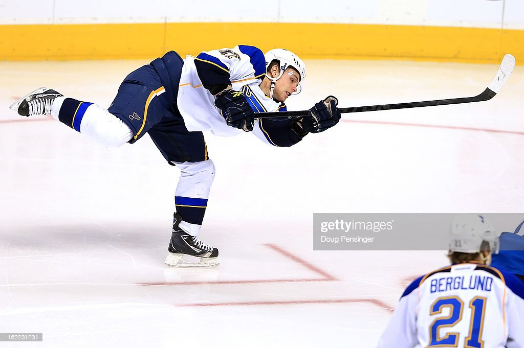 Scott Nichol of the St Louis Blues takes a shot against the Colorado Avalanche at the Pepsi Center on February 20 2013 in Denver Colorado The...