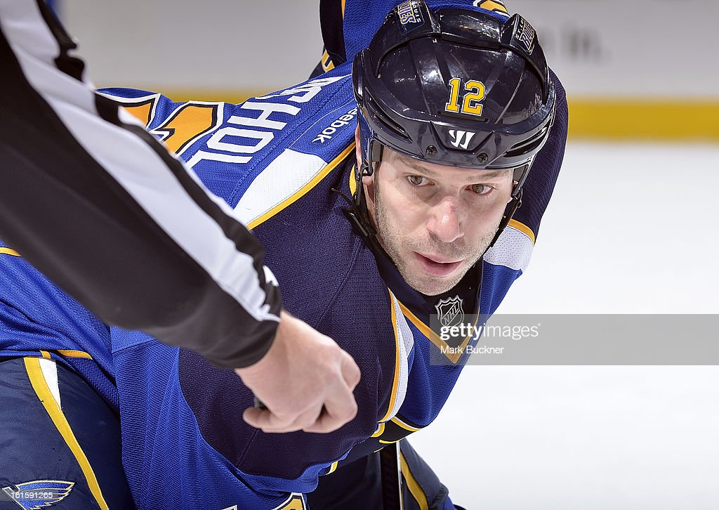 Scott Nichol #12 of the St. Louis Blues waits to take a face-off against the Los Angeles Kings in an NHL game on February 11, 2013 at Scottrade Center in St. Louis, Missouri.
