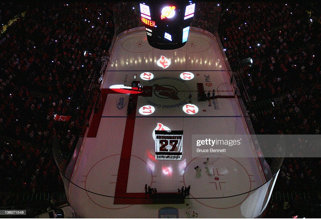 <a gi-track='captionPersonalityLinkClicked' href=/galleries/search?phrase=Scott+Niedermayer&family=editorial&specificpeople=201656 ng-click='$event.stopPropagation()'>Scott Niedermayer</a> has his jersey lifted to the rafters during his retirement ceremony hosted by the New Jersey Devils prior to the game against the Dallas Stars at the Prudential Center on December 16, 2011 in Newark, New Jersey.
