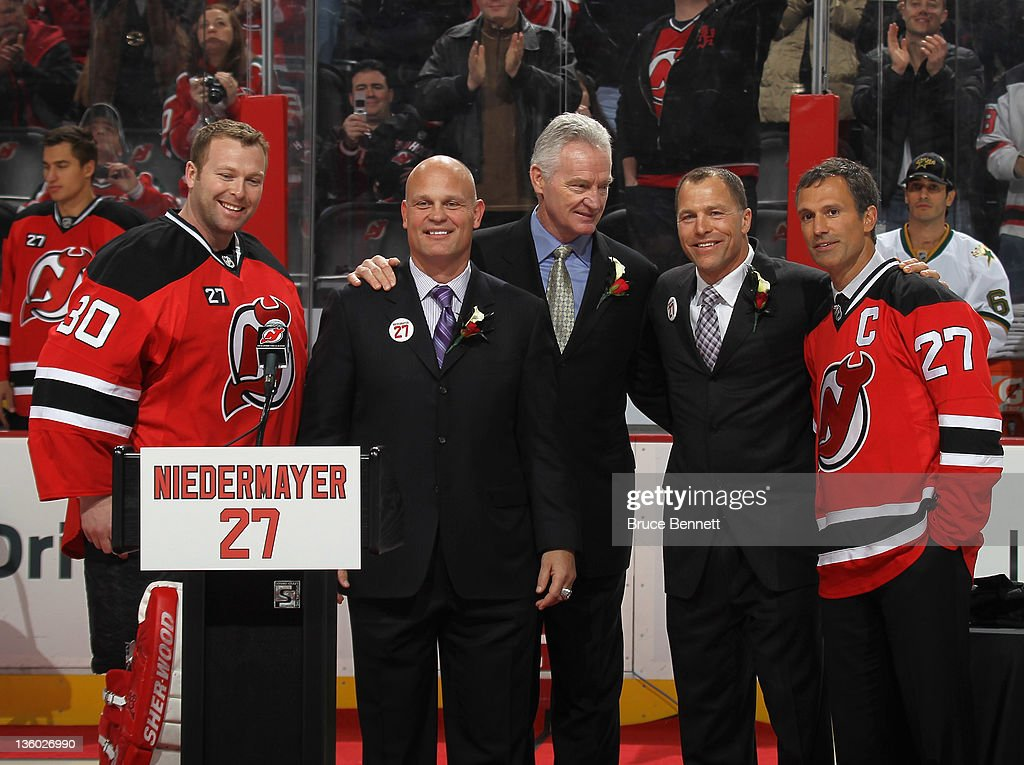 Scott Niedermayer (R) is joined by (R-L) Martin Brodeur, Ken Daneyko, Larry Robinson and Scott Stevens during his jersey retirement ceremony by the New Jersey Devils prior to the game against the Dallas Stars at the Prudential Center on December 16, 2011 in Newark, New Jersey.