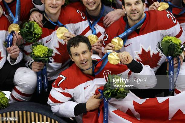 Scott Niedermayer of Canada celebrates with his team after winning the gold medal after the ice hockey men's gold medal game between USA and Canada...