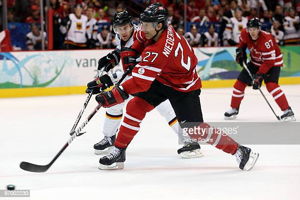 Scott Niedermayer of Canada scores a goal against Germany during the ice hockey Men's Qualification Playoff game between Germany and Canada on day 12...