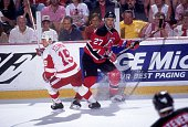 Scott Niedermayer of the New Jersey Devils and Steve Yzerman of the Detroit Red Wings skate on the ice during Game 2 of the 1995 Stanley Cup Finals...