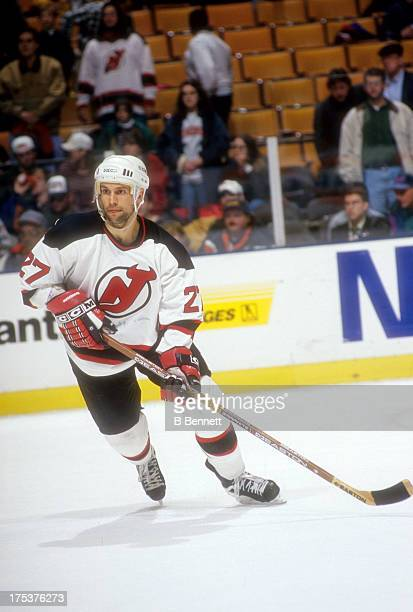 Scott Niedermayer of the New Jersey Devils skates on the ice during an NHL game in April 1996 at the Brendan Byrne Arena in East Rutherford New Jersey