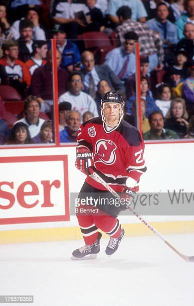 Scott Niedermayer of the New Jersey Devils skates on the ice during an NHL game against the Philadelphia Flyers circa 1993 at the Spectrum in...