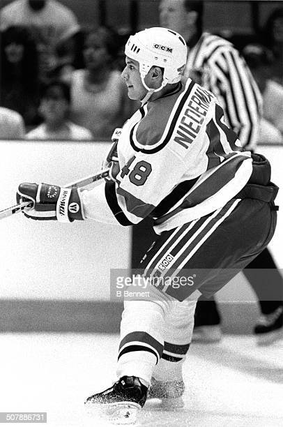 Scott Niedermayer of the New Jersey Devils skates on the ice during an NHL game circa 1991 at the Brendan Byrne Arena in East Rutherford New Jersey