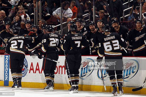 Scott Niedermayer Steve Eminger Ryan Carter Troy Bodie of the Anaheim Ducks high five teammates after a goal in the third period from Ryan Carter...