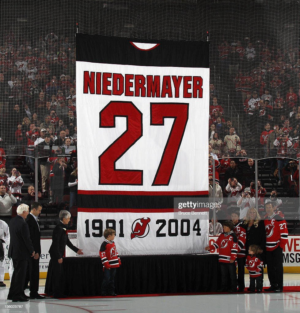 <a gi-track='captionPersonalityLinkClicked' href=/galleries/search?phrase=Scott+Niedermayer&family=editorial&specificpeople=201656 ng-click='$event.stopPropagation()'>Scott Niedermayer</a> (R) takes part in his jersey retirement ceremony by the New Jersey Devils prior to the game against the Dallas Stars at the Prudential Center on December 16, 2011 in Newark, New Jersey.