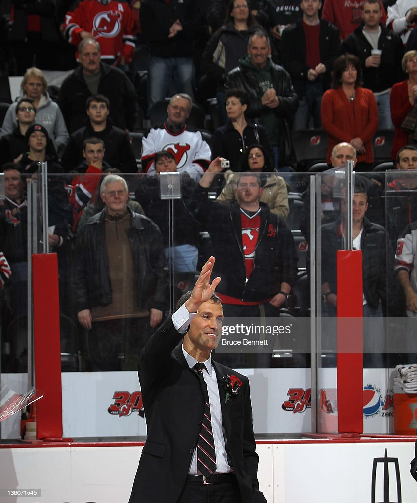 <a gi-track='captionPersonalityLinkClicked' href=/galleries/search?phrase=Scott+Niedermayer&family=editorial&specificpeople=201656 ng-click='$event.stopPropagation()'>Scott Niedermayer</a> takes part in his jersey retirement ceremony by the New Jersey Devils prior to the game against the Dallas Stars at the Prudential Center on December 16, 2011 in Newark, New Jersey.