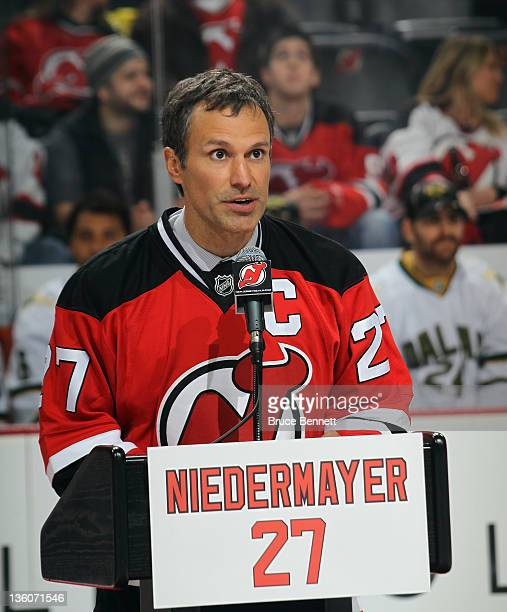 Scott Niedermayer takes part in his jersey retirement ceremony by the New Jersey Devils prior to the game against the Dallas Stars at the Prudential...