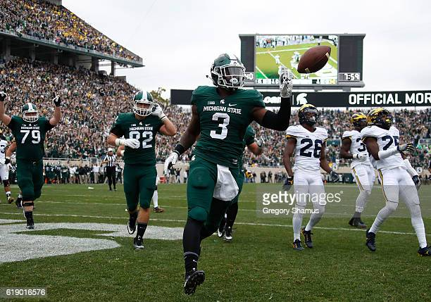 Scott of the Michigan State Spartans celebrates a first quarter touchdown while playing the Michigan Wolverines at Spartan Stadium on October 29 2016...