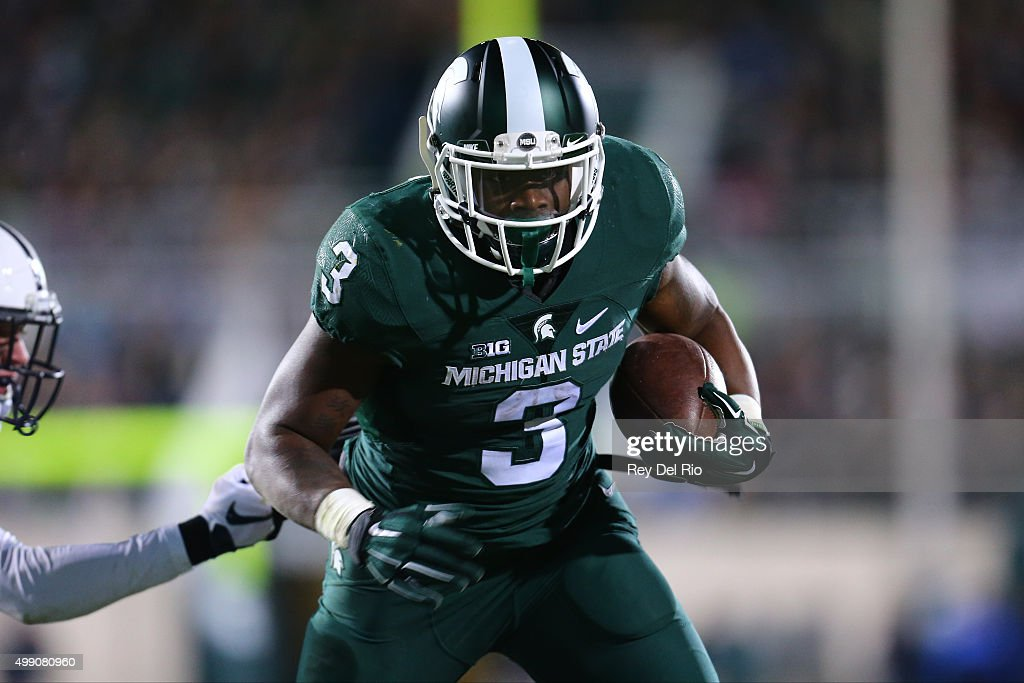 LJ Scott #3 of the Michigan State Spartans runs the ball and scores a touchdown in the fourth quarter against the Penn State Nittany Lions at Spartan Stadium on November 28, 2015 in East Lansing, Michigan.