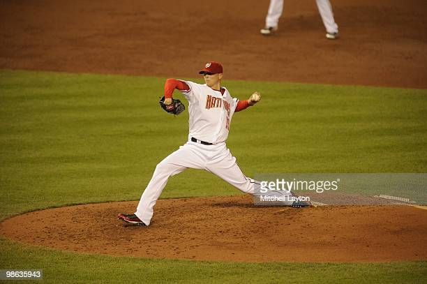 Scott Olsen of the Washington Nationals pitches during a baseball game against the Colorado Rockies on April 20 2010 at Nationals Park in Washington...
