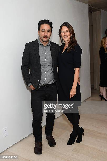 Scott Oster and Anna Getty attend NETAPORTER Celebrates Rosetta Getty on November 20 2014 in Los Angeles California