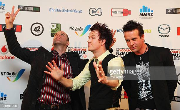 Scott Owen Andy Strachan and Chris Cheney of The Living End pose backstage during the 2009 Vodafone Music Awards at Vector Arena on October 8 2009 in...