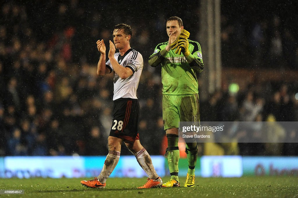 Scott Parker and David Stockdale of Fulham applaud the fans following their team's 2-1 victory during the Barclays Premier League match between Fulham and West Ham United at Craven Cottage on January 1, 2014 in London, England.