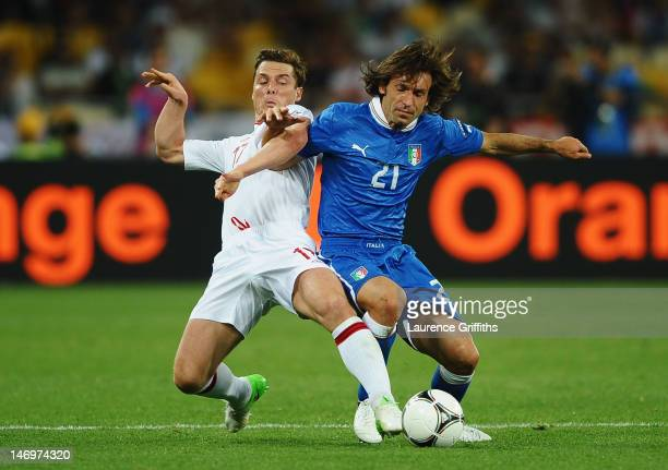Scott Parker of England and Andrea Pirlo of Italy challenge for the ball during the UEFA EURO 2012 quarter final match between England and Italy at...