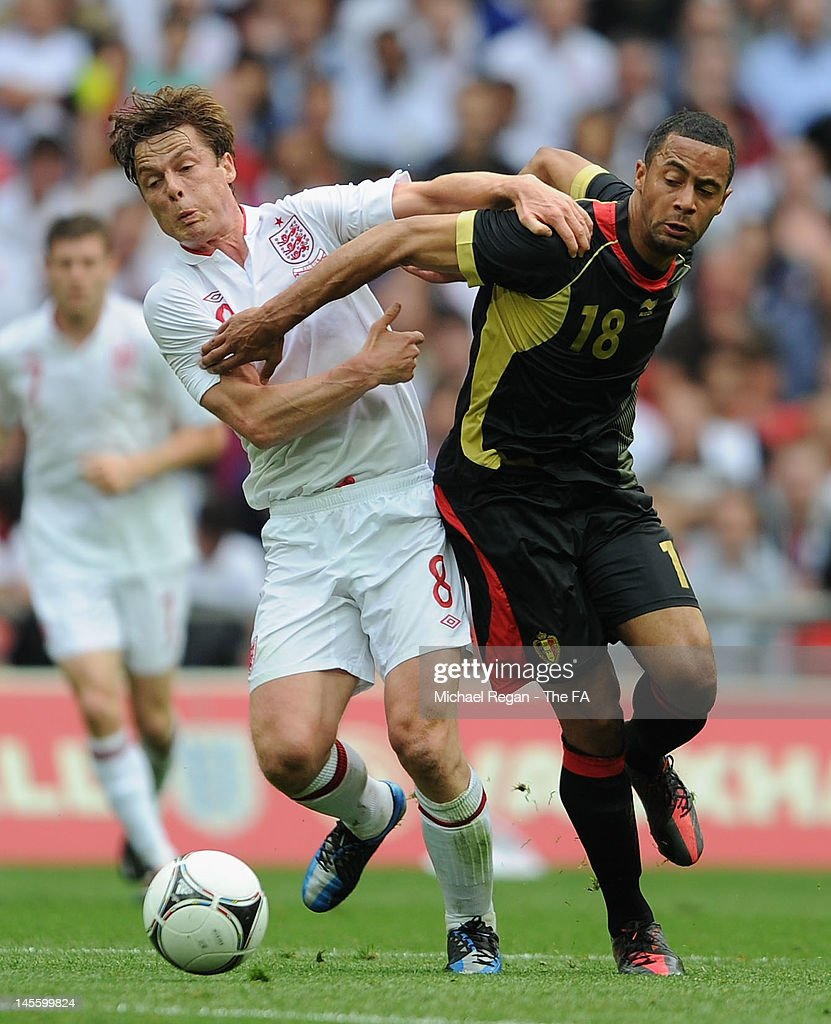 Scott Parker of England and Moussa Dembele of Belgium battle for the ball during the International Friendly match between England and Belgium at Wembley Stadium on June 2, 2012 in London, England.