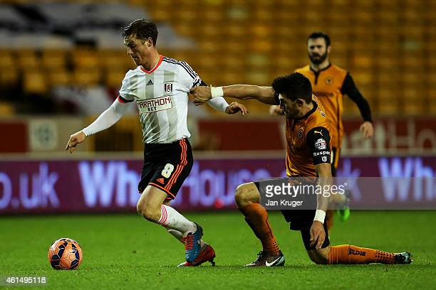 Scott Parker of Fulham battles for the ball with Danny Batth of Wolves during the FA Cup third round replay match between Wolverhampton Wanderers and...