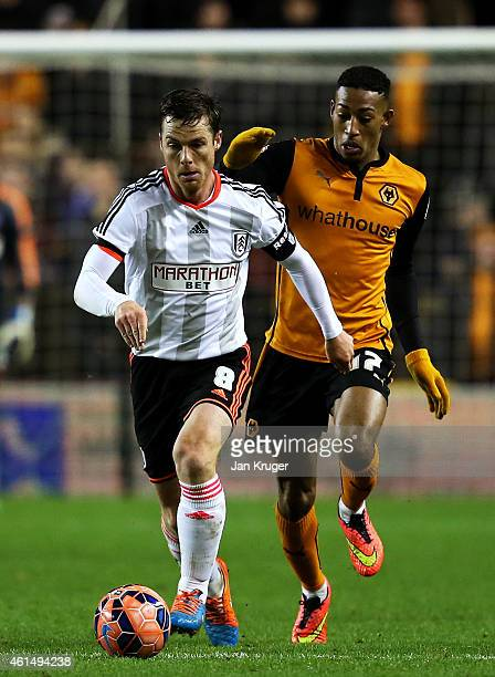 Scott Parker of Fulham battles for the ball with Rajiv Van La Parra of Wolves during the FA Cup third round replay match between Wolverhampton...