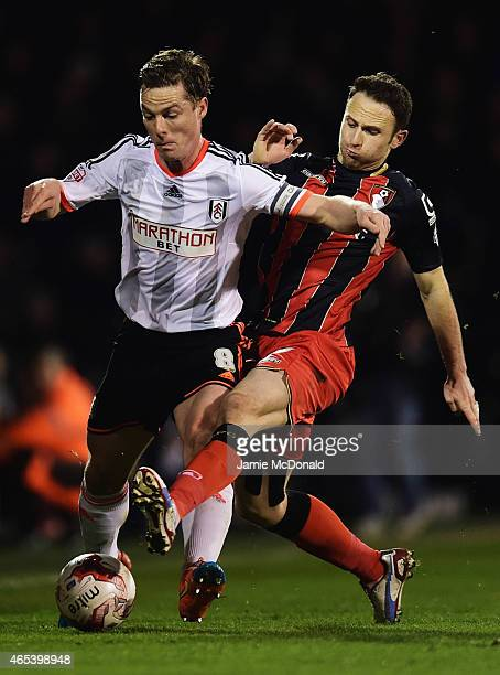 Scott Parker of Fulham holds off Marc Pugh of Bournemouth during the Sky Bet Championship match between Fulham and AFC Bournemouth at Craven Cottage...