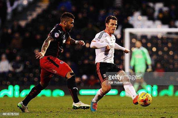 Scott Parker of Fulham holds off the challenge of Daniel Williams of Reading during the Sky Bet Championship match between Fulham and Reading at...