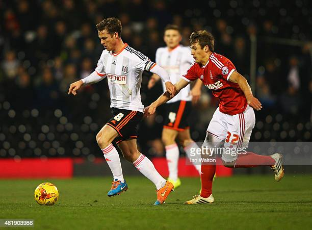 Scott Parker of Fulham is chased by Robert Tesche of Nottingham Forest during the Sky Bet Championship match between Fulham and Nottingham Forest at...