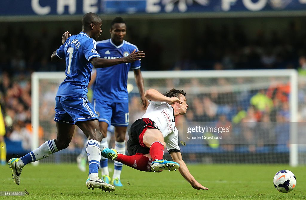 Scott Parker of Fulham is tripped by Ramires of Chelsea during the Barclays Premier League match between Chelsea and Fulham at Stamford Bridge on September 21, 2013 in London, England.
