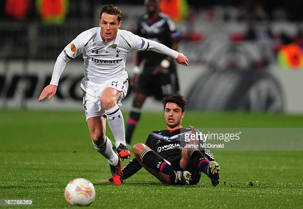 Scott Parker of Spurs battles with Clement Grenier of Olympique Lyonnais during the UEFA Europa League Round of 32 second leg match between Olympique...