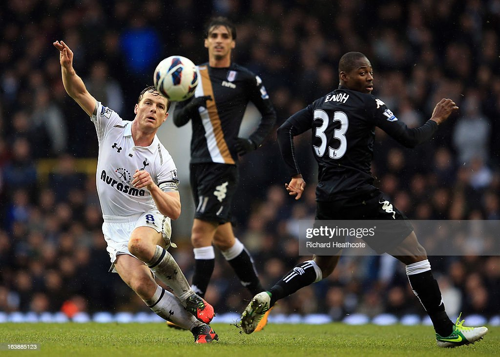 Scott Parker of Tottenham battles with <a gi-track='captionPersonalityLinkClicked' href=/galleries/search?phrase=Eyong+Enoh&family=editorial&specificpeople=4134782 ng-click='$event.stopPropagation()'>Eyong Enoh</a> of Fulham during the Barclay's Premier League match between Tottenham Hotspur and Fulham at White Hart Lane on March 17, 2013 in London, England.