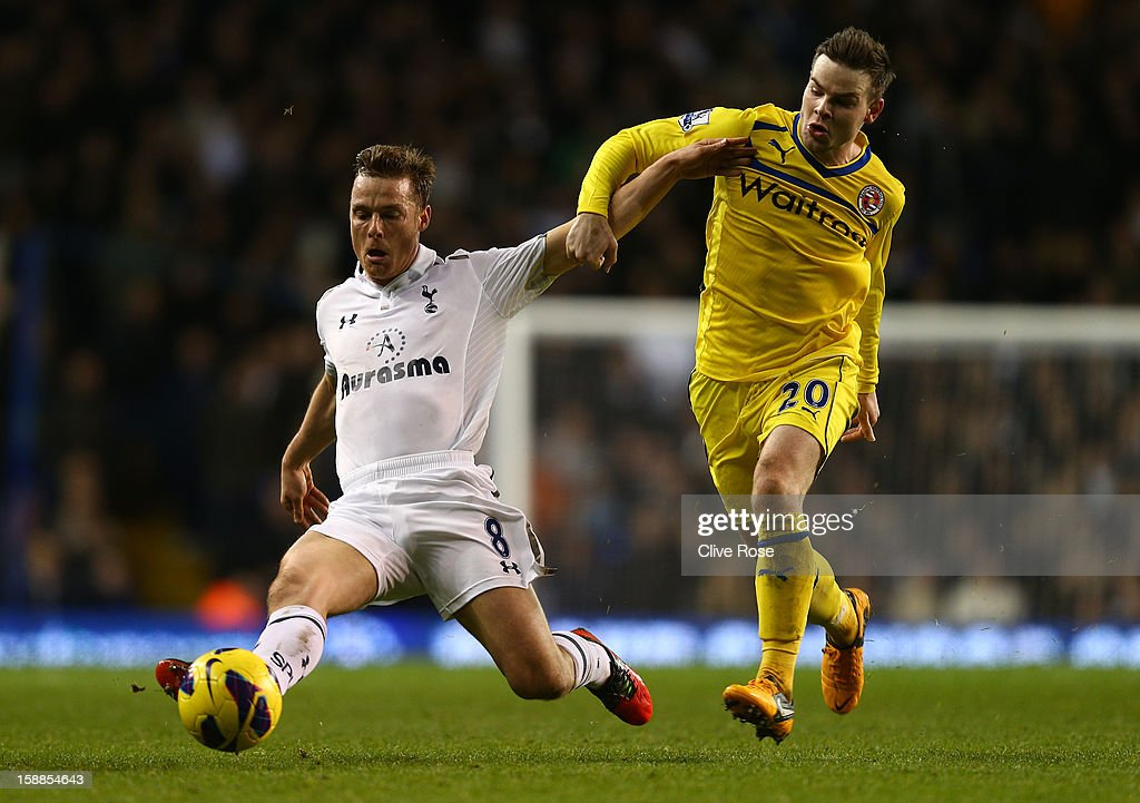Scott Parker of Tottenham Hotspur and <a gi-track='captionPersonalityLinkClicked' href=/galleries/search?phrase=Danny+Guthrie&family=editorial&specificpeople=747593 ng-click='$event.stopPropagation()'>Danny Guthrie</a> of Reading battle for the ball during the Barclays Premier League match between Tottenham Hotspur and Reading at White Hart Lane on January 1, 2013 in London, England.