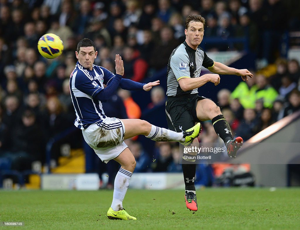 Scott Parker of Tottenham Hotspur is challenged by Graham Dorrans of West Bromich Albion during the Barclays Premier League match between West Bromwich Albion and Tottenham Hotspur at The Hawthorns on February 3, 2013 in West Bromwich, England.