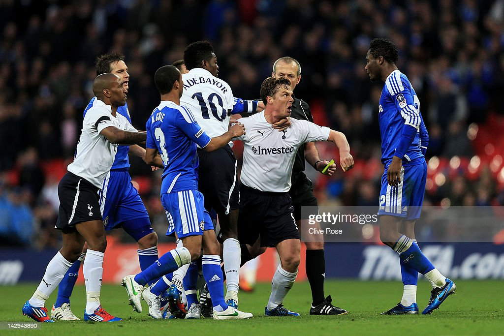 Scott Parker of Tottenham Hotspur is restrained as he clashes with John Obi Mikel of Chelsea (R) during the FA Cup with Budweiser Semi Final match between Tottenham Hotspur and Chelsea at Wembley Stadium on April 15, 2012 in London, England.